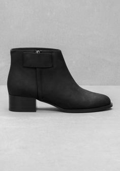 Crafted from soft, fine leather, these comfortable ankle boots has a discreet over layering detail and an almond toe.
