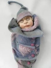 A needlefelted baby