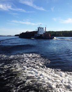 Wood on its way to south on lake Saimaa