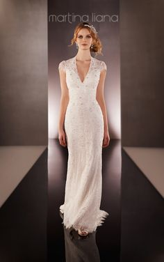 Lace keyhole back wedding dress with a low V-neck, cap sleeves and a sweep train. Sheath Lace over Lustre Satin designer bridal gown from Martina Liana.