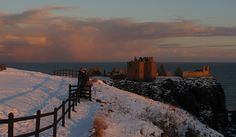 Dunnottar Castle in Aberdeenshire, Scotland, around sunset on Christmas Eve 2010.    Hope this couple don't mind that I photographed their romantic moment!     Incredible