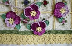 Darling Pansy Bunting & I love everything (colors, pattern & edging about the blanket!