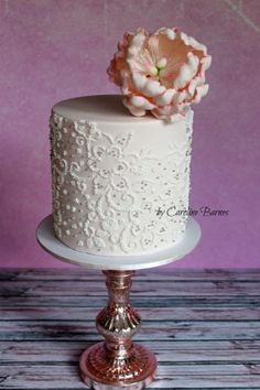 Beaded embroidery cake topped with a gumpaste peony