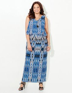 Dripping with color and fresh patterns, our beautiful maxi dress guarantees a figure-flattering look with every wear. We designed this maxi with a pop-over top that skims your waistline for a silhouette-enhancing effect. V-neckline. Darted bust for added fit. Sleeveless. Catherines dresses are expertly designed for the plus size woman. catherines.com