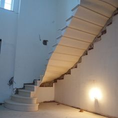 Stone staircase cantilever in French limestone or Portland limestone