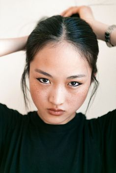 Model Jing Wen demonstrates a wearable, subtle cat eye that can be achieved with any gel eyeliner pencil.