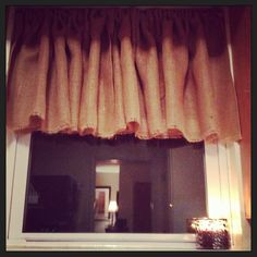 Burlap window valance - cost just $5.00 to make. No sew! Just fold over top and iron with fabric bond. Easy and cheap.