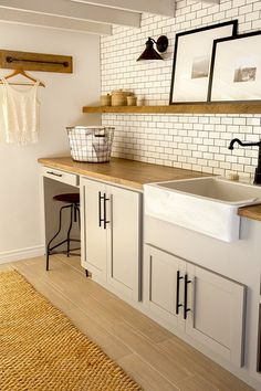 This laundry room looks so rustic modern.