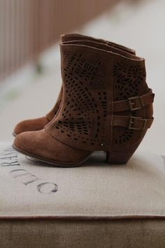 Laredo Cut Out Suede Shorties, from NanaMacs Boutique. These booties are a must have for your closet. (http://www.nanamacs.com/laredo-cut-out-suede-shorties/)
