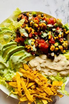 This healthy salad is filled with many Mexican inspired flavors. Black bean and roasted corn salsa, sliced avocado, cashew queso, and homeade tortilla strips all on top a crisp bed of romaine lettuce. The salad is finished with a dairy free cilantro ranch dressing. It is such a satisfying meal with so many flavors and textures. Cilantro Ranch Dressing, Healthy Salads, Healthy Recipes, Lunches And Dinners, Meals, Vegan Queso, Mexican Salads, Bean Salsa, Roasted Corn