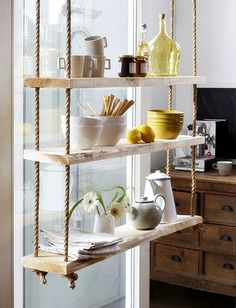 PRETTY STORAGE IDEA ~~ Shelves for added space but also as creative accent. I love this homey display of ceramic cookware - unfinished look of wood, hung directly in front of window to highlight it.