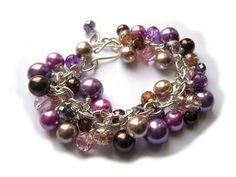 Pearl Cluster Bracelet - Purple, Pink & Brown  £22.00  Beautiful beaded cluster bracelet with pink, purple, brown and beige glass pearls and beads on a silver plated chain finished with a handmade s-clasp. Size: 7 - 8""