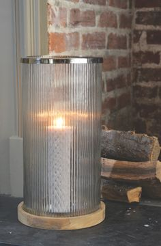 Libra's Ribbed Glass Cylinder Hurrican with Wood - http://www.artisanti.com/ribbed-glass-cylinder-hurricane-with-wooden-base-13897-p.asp