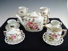 Antique toy tea set hand painted Heubach DEP c. 1800's.  LOVE these...doubt I will ever have them though!