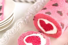 """Earlier this week, Foodista shared some of our favorite heart shaped treats for Valentine's Day. However, Cleobuttera's""""Love is all Around"""" cake roll wins the blue ribbon. Not only is it fun, festive, and delicious but"""