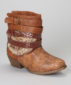 Snake print, faux fur and buckled straps, oh my! This sturdy, low-heel boot is happily setting trends and breaking hearts along the way.