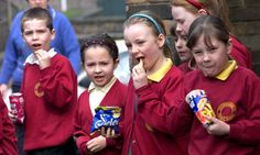 Schoolchildren eating crisps