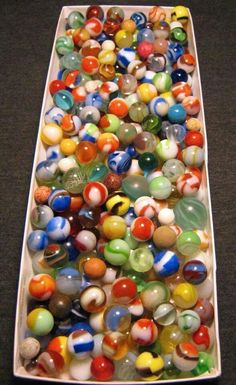 Box of marbles. We used to be able to buy small bags if marbles to play games with or to collect. Some now are quite valuable.
