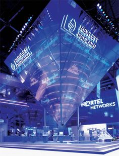 Tradeshow exhibit with large wayfinding structure; Stand design