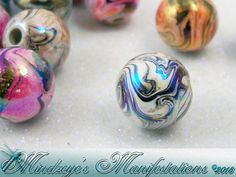50 Swirled  Acrylic 8mm Beads with AB Finish. Starting at $4 on Tophatter.com!