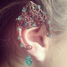 Woodland elf ear in antique copper with filigree, green crystals, and leaf dangle. $30 each ear.