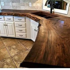 Beautiful counter. Cheap cabinets, floor and backsplash.