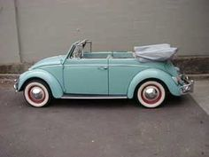 antique aqua vw beetle convertible