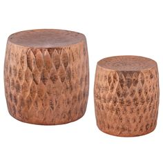 """The Djembe stool set offers a contemporary update to classic drum design. In a distressed copper finish, these furnishings captivate with intriguing leaf-shaped texture. Iron; Set of 2; 18""""W x 18""""D x 18""""H"""