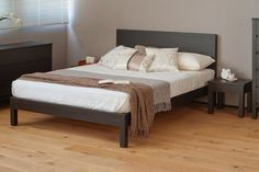 A stylish, contemporary wooden bed with a padded headboard for extra comfort. This solid wood bed is enhanced with a classic fabric headboard. Black Bedroom Furniture, Bedroom Decor, Fine Furniture, Bedroom Ideas, Japanese Style Bed, Low Platform Bed, Monochrome Bedroom, Minimalist Sofa, Narrow Living Room