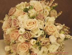 BG33 `Sahara` roses, `Creme de Menthe` roses and `Akito` roses with white ranunculus, white freesias and pieris