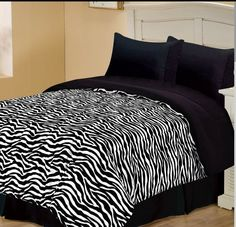 Zebra comforter this look exactly like mine except i have greenish blue sheet set not black