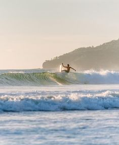 Surfer catching a wave in Tamarindo Costa Rica. Surfboards, surf art, surf photography, surfs up, waves, surfing, surfers, surf, Costa Rica surf, surfer girl, surf lifestyle, surf style, surf culture, surf sunset, surf inspiration, surf prancha, onda, olas, beach, retro surf, vintage surf, surf dreams, surf California, surf style inspiration, surf style boho