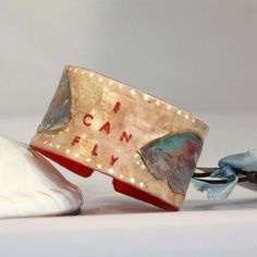 """Painted leather cuff """"I Can Fly"""" - hand stamped & painted"""