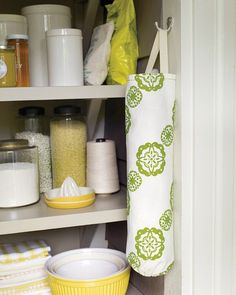 DIY Plastic Bag Organizer Tutorial : plastic bags seem to multiply, even if you try to take fewer of them from stores. Make sure you reuse them; its easy when they're in a handy holder that matches your kitchen decor. Learn how to make one via Martha Stewart.