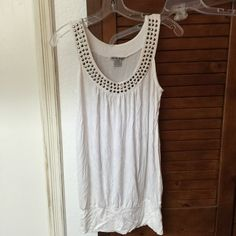 "White Long Tank Tee w/Pewtertone studs Sz L 18"" armpit to armpit. Stretch Tee. Wear long, hiked up. 23"" long. As pictured American Dream Tops Tank Tops"