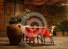 Red table for two in tuscany