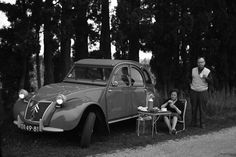 road trip in a 2CV with a break for a picnic lunch.