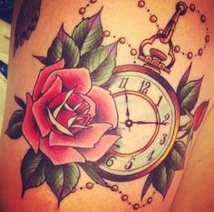 Rose & pocket watch tattoo. Reminds me a lot of Alice in Wonderland :) love love love.