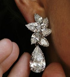 Amazing diamond ear clip The diamond ear clips from the collection of Lily Marinho comprises of two clusters of pear-shaped diamond, weighing 11.08 and 11.66 carats and are expected to fetch between $ 1,200,000 and $ 2,000,000.