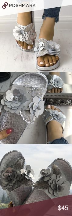 Silver Flower Embellished Slides Make these comfortable beaded slide sandals a staple piece in your casual summer wardrobe, featuring a with a metallic upper and outsole.  Product Features  PU Upper, rubber outsole Shoes Sandals
