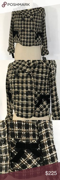 Anna Sui tweed jacket US size 6 New with tags black tweed jacket UK size 2, US size 6  Ⓜ️size 6 Ⓜ️Bust 40 Ⓜ️length 19 Ⓜ️Sleeves 21   New with tags black tweed mix with tan and white, bow detail, 3/4 sleeves, 2 front pockets, 4 button front, UK size 2 US size 6. 90% acrylic 10% polyester. Retail $546 + tax    ✅Bundle and save  ✅🚭 🚫No Trading 🙅🏻 Poshmark rules only‼️ Anna Sui Jackets & Coats Blazers