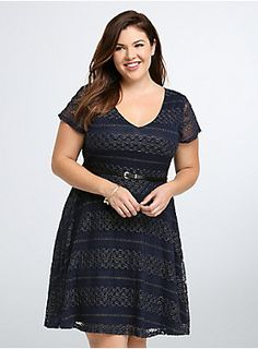 "<p>Put the pedal to the metal(lic) and gear up to sport this skater dress at every holiday party from now until forever. Gorgeous navy blue knit covers the super-stretchy style (comfy for dinner to dancing) while gold tone metallic threading will light up any room. A black faux leather belt cinches the swingy style.</p><ul>	<li>Size 1 measures 41"" from shoulder</li>	<li>Nylon/spandex/other fiber/polyester</li>	<li>Wash cold, dry flat</li>	<li>Imported plus size dress</li></ul>"