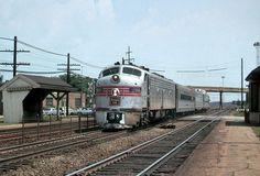 The Burlington Route's train No. 11, the westbound Nebraska Zephyr, glides through Berwyn, Illinois behind 2400-horsepower EMD E8A un...