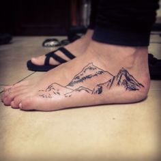 mountain range foot tattoo