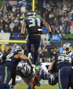 Kam Chancellor aka The Dark Knight or Kam Quake leaping like a gazelle over the Carolina Panthers!