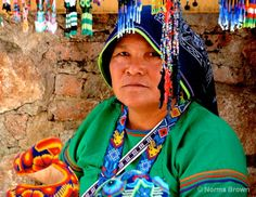 Huichol lady in Real de Catorce showing their stuff, San Luis Potosi    Photo: Norma Brown