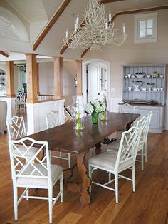 Suzie: Frank Roop - Wood dining table, white faux bamboo armchairs and white branch chandelier! ...