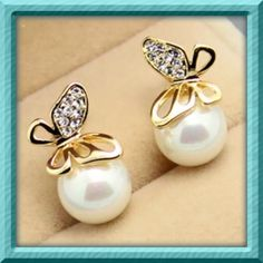 Butterfly Pearl Crystal Earrings Condition:  Brand New & High quality. Main color:  Gold /white material:  Alloy , Imitation Pearl Style :  Crystal Golden Butterfly Imitation Pearl Butterfly Size : 1.0cm*1.0cm Pearl Diameter :1.0cm  1 inch = 2.54cm or 1cm = 0.393 inch Jewelry Earrings
