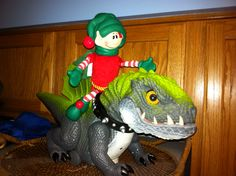 Christopher Pop-In Kins riding a dinosaur