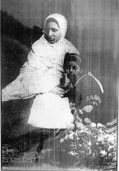 3. Rama became a widow at age 22. She's wearing widow's white. Rama's daughter, Manorama, is with her.